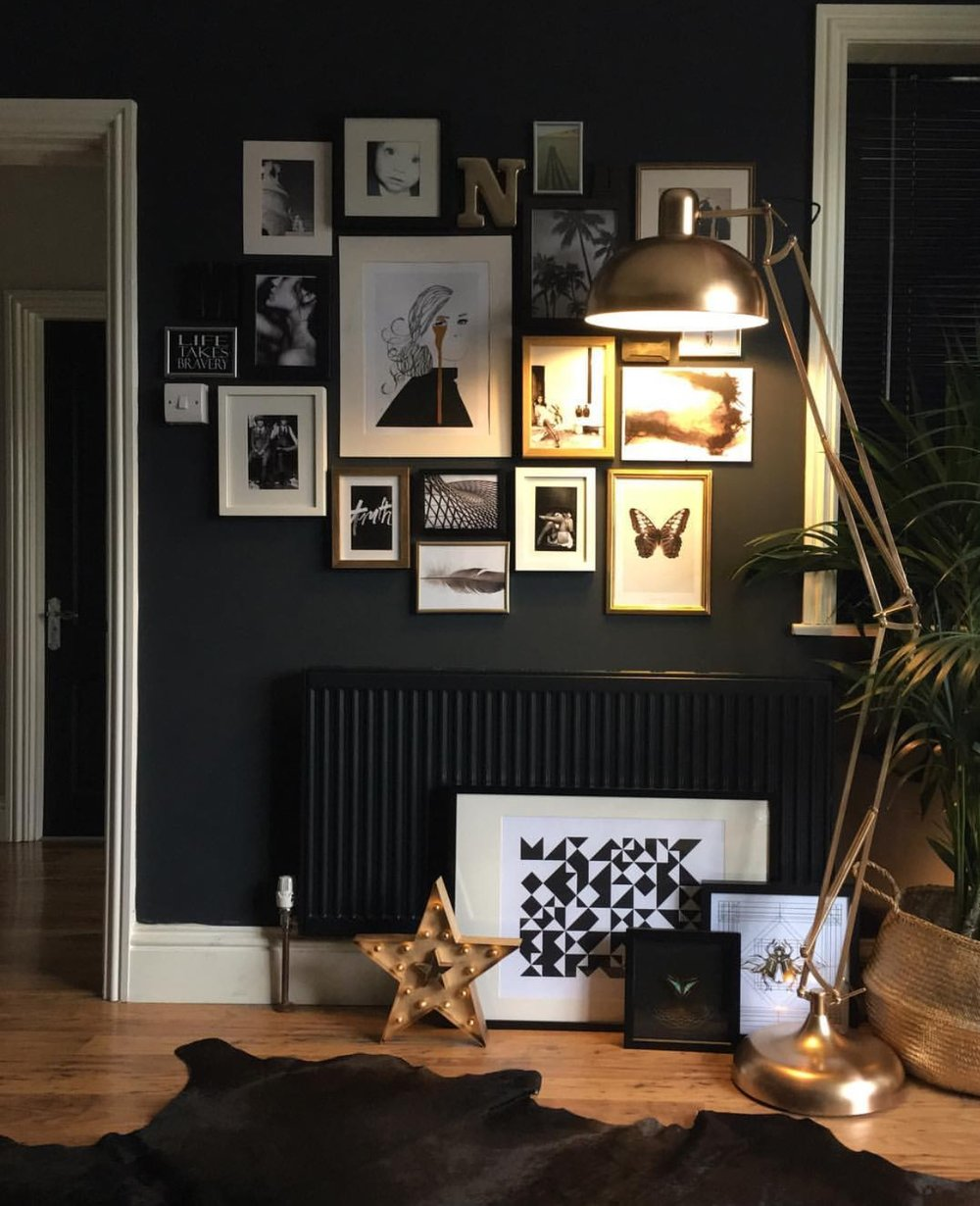 "Another example of a beautiful gallery wall. ""This wall had been bare for ages apart from the odd piece of art hung every now and then,"" Nadia explains. ""I found old pictures in many different places, bought new pictures, and collected bits and pieces... I have a thing about gallery walls not having gaps, I don't know why, I've always done it that way. I like them to fit like a mosaic, but that's just me."""