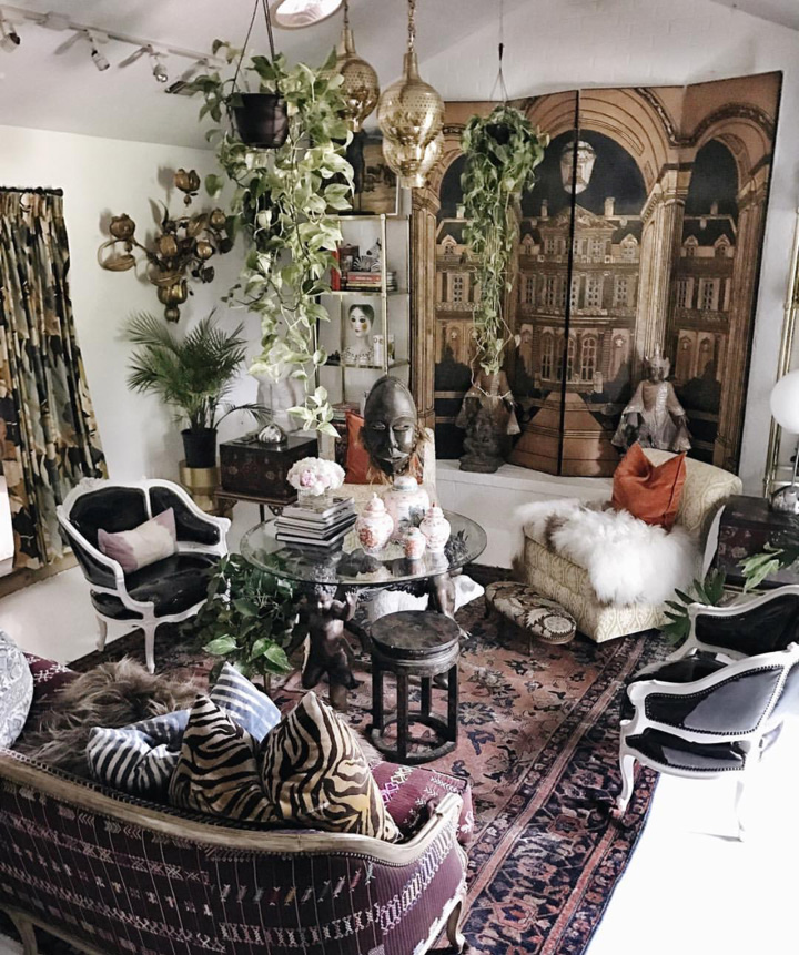 Plants hang from every ceiling in Judy's house, an idea she picked up in a cafe in Europe. Judy found the ornate folding screen in her living room at  Consignment Haven , one of her favorite stores in Dallas.