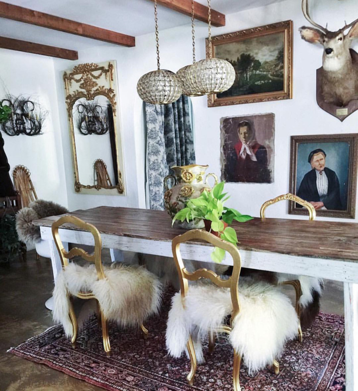 Fabulous art and finding something quirky, such as the deer head above, is what Judy does best. Oh and textiles, rugs sheepskins, curtains. pattern mixing at its best. The dining area sits between the kitchen and the living room and is a walk through.