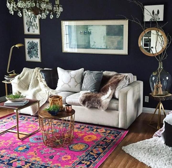 A stunning rug against dark blue walls.
