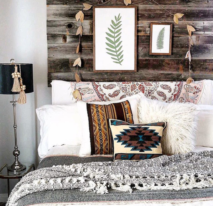 When a 2 dollar thrifted Navajo handbag becomes a pillow! Kate's bedroom features more reclaimed wood for a lovely rustic feel.