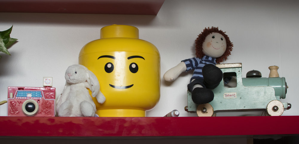 A lego storage box, fisher price camera and vintage train