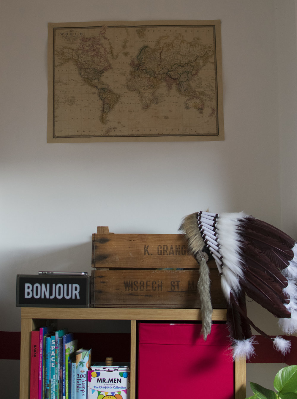Old Apple Crates used as storage, an Indian Head piece sourced from etsy and the Bonjour Lightbox from Mandrawer new homeware collection