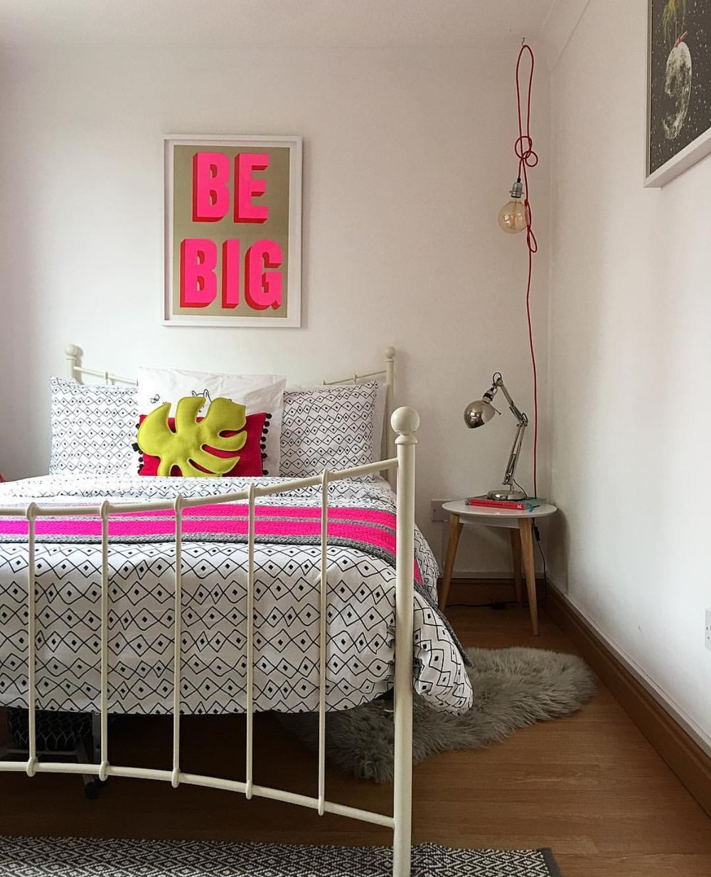 Guest bedroom detail, 'Be Big' print: Print Club London, Bedding: IKEA, Leaf: Sofa Leafs, Red pendant wires: Wickle (independent shop in Lewes, East Sussex)