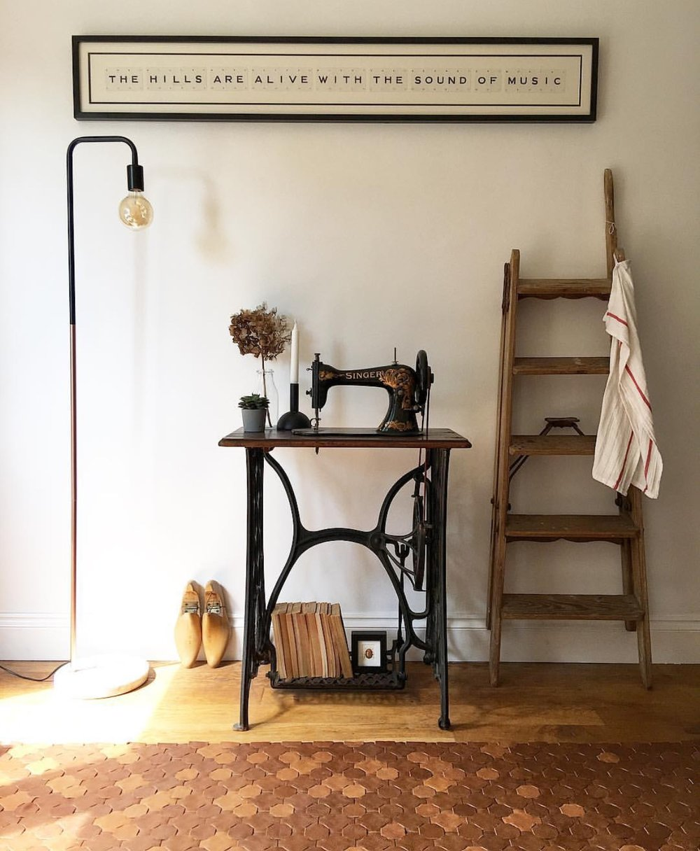 Kitchen Detail: Bespoke 'The hills are alive with the sound of music' frame- Vintage Playing Cards, Vintage ladder: Lewes Antiques Centre, Reclaimed leather rug: Elvis and Kresse