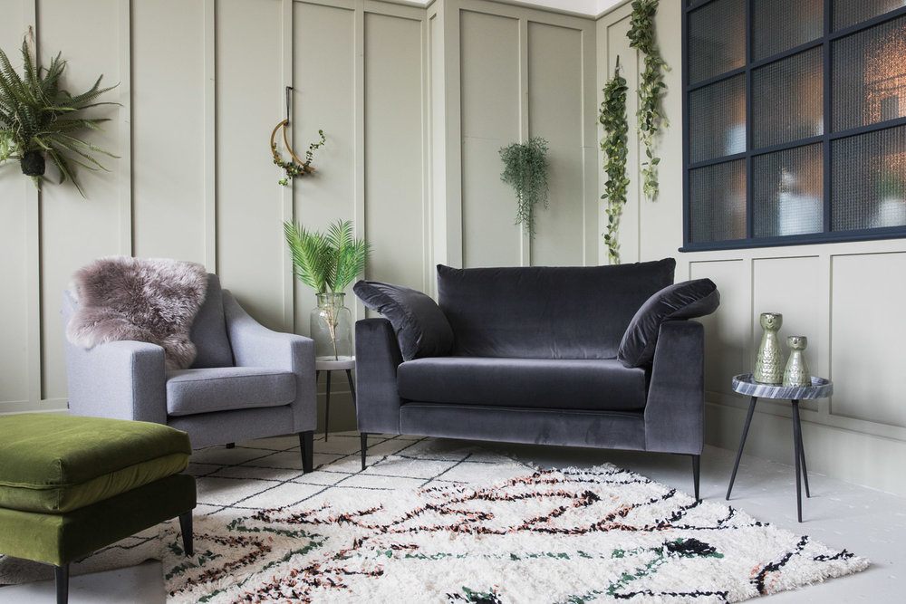 Epsom Snuggler in dark grey velvet, Broughton ottoman in green velvet and a classic chair in grey