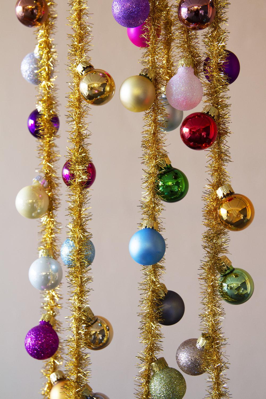 rockettstgeorge_rainbow_christmas_tree_garland_lifestyle_highres.jpg