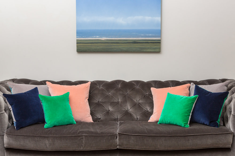 Emerald, Blush, Navy and Grey cushions on sofa copy.jpg