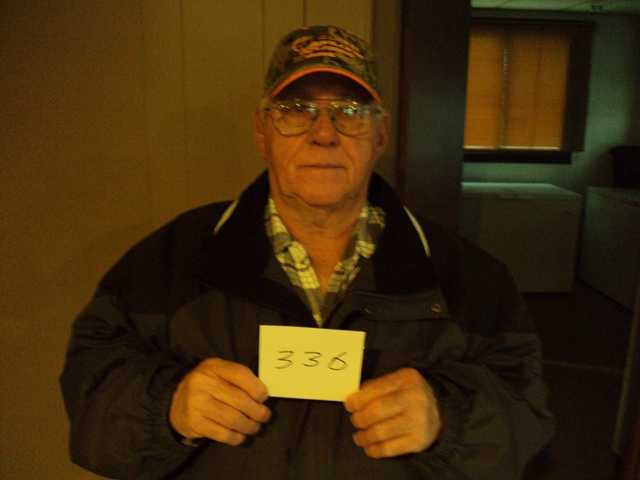 """Wilton """"Hooch"""" Schilling of Akaska, SD drew the winning number this Monday morning at the Akaska Bait Shop, Bar & Grill. Hooch drew the number for Audie Crouch of Agar, SD. Audie wins a Watherby PA-08 Shotgun.  CONGRATULATIONS AUDIE."""