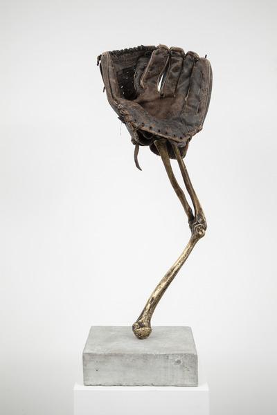 Esperando que caigan las cosas del cielo, o Deporte Nacional, 2012. Bronze, concrete, and baseball glove, 30 1/2 x 9 7/8 x 9 7/8 in. No. 14 of 35 parts in the original installation.