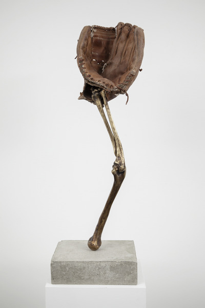 Esperando que caigan las cosas del cielo, o Deporte Nacional, 2012. Bronze, concrete, and baseball glove, 31 1/2 x 9 7/8 x 9 7/8 in. No. 15 of 35 parts in the original installation.