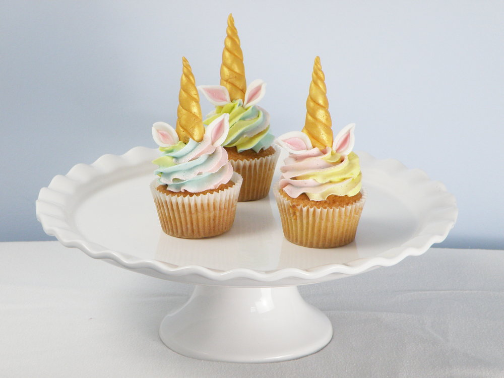 Unicorn cupcakes - Vanilla sponge filled with your favourite jam and finished with rainbow coloured buttercream and o!....a golden horn.6 cupcake box- £1212 cupcake box- £24