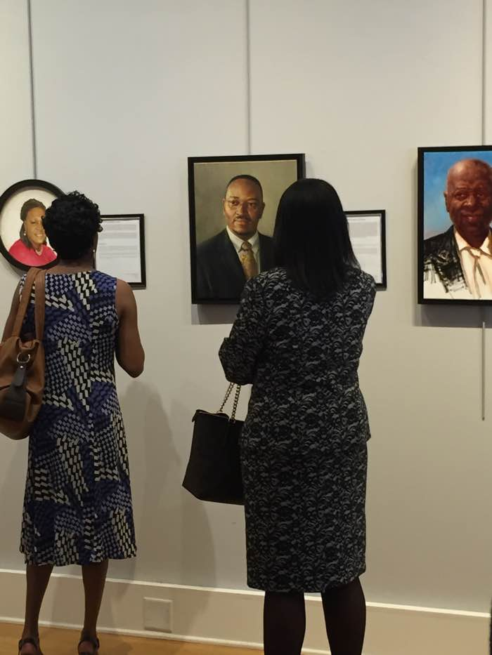 One of the Emanuel ministerial staff looking at Reverend Pinckney's portrait