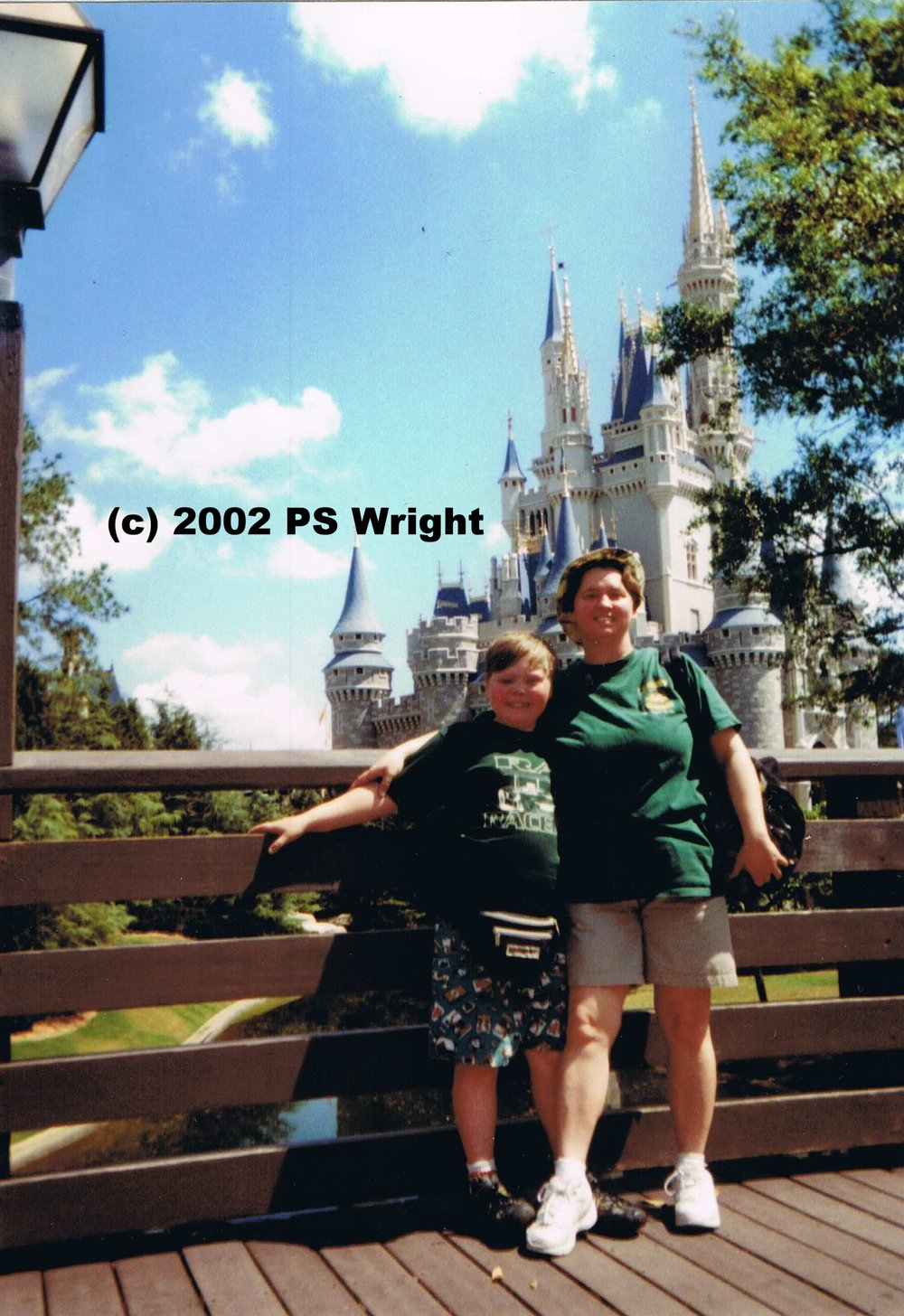 A family photo. (Only if not for sale or redistribution as it contains a themepark icon and logos on both shirts.)
