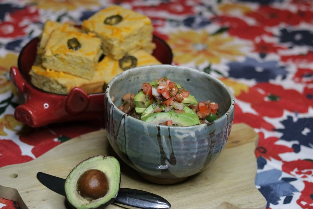 Spicy pinto beans with avocado and pico de gallo; jalapeno cheddar cornbread