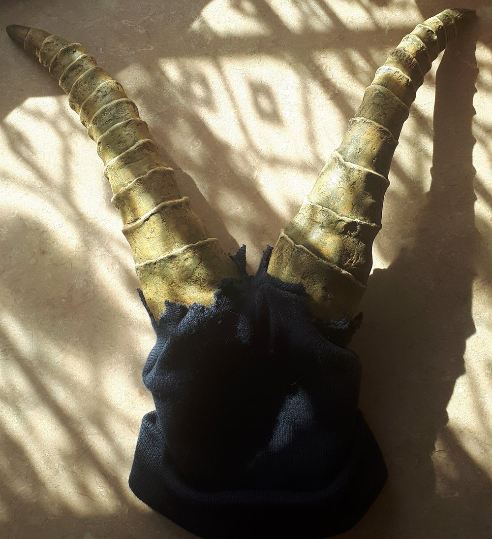 My Púca horns, made from wire, foil, plaster bandage and polyfilla. They turned out a little heavier than I intended but they're really strong so I'm hoping they'll last. I've recently started playing with EVA foam so that might be a potential replacement material down the line.