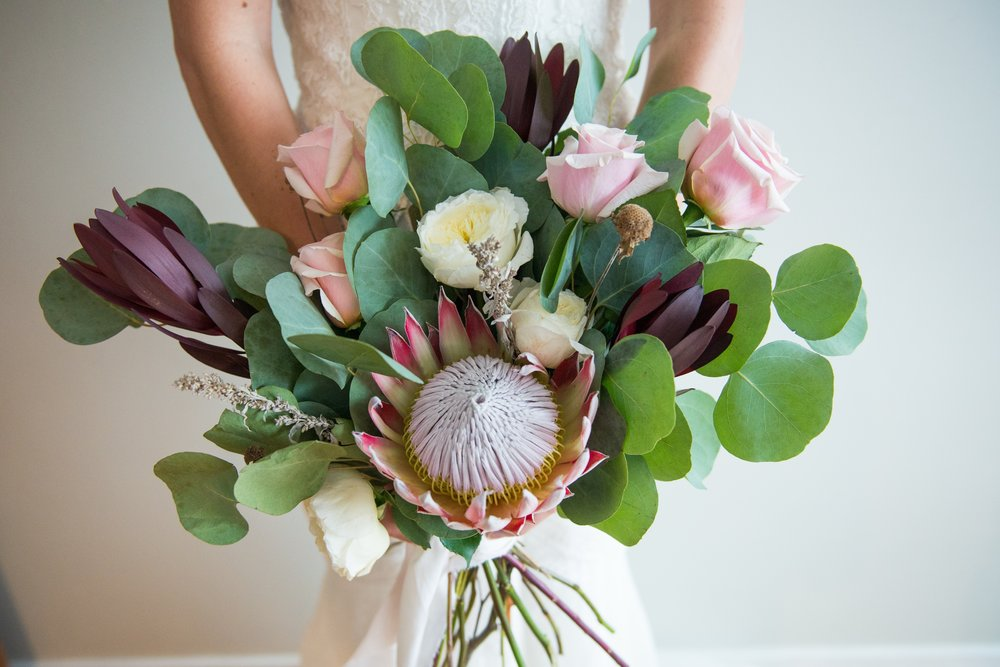 Simple bouquet roses protea