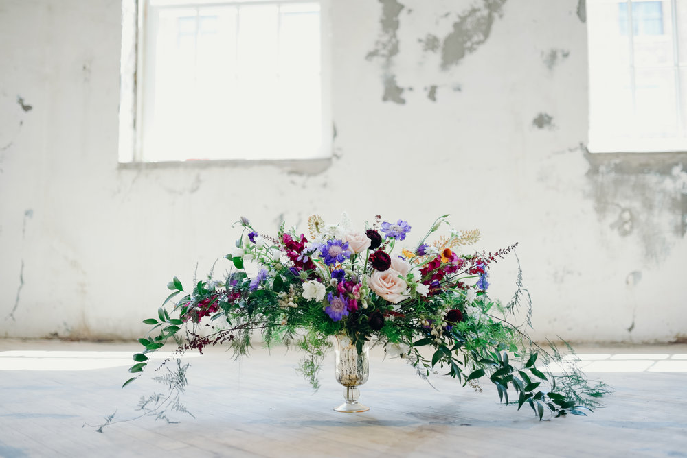 Lush and whimsical floral arrangement