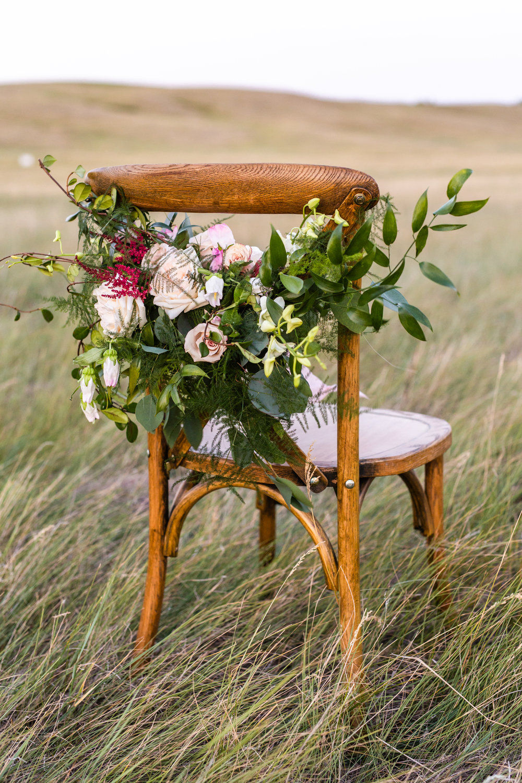 Wedding chair reception floral