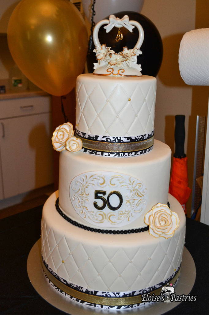 Black, Gold and White Anniversary Cake