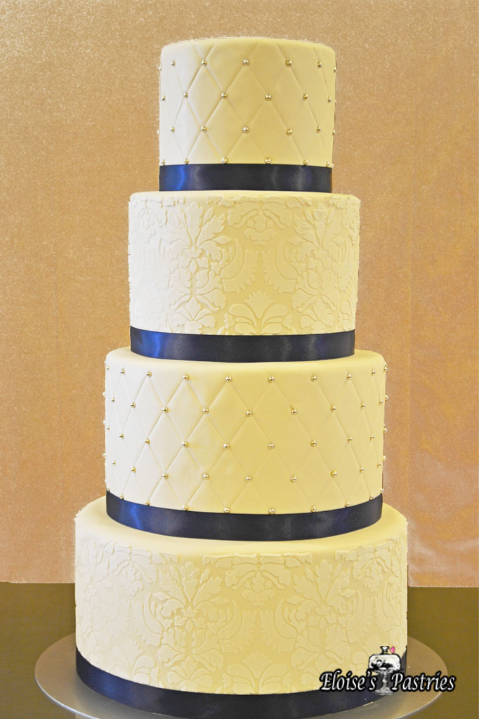 Ivory Quilted Textured Blue Ribbon Cake