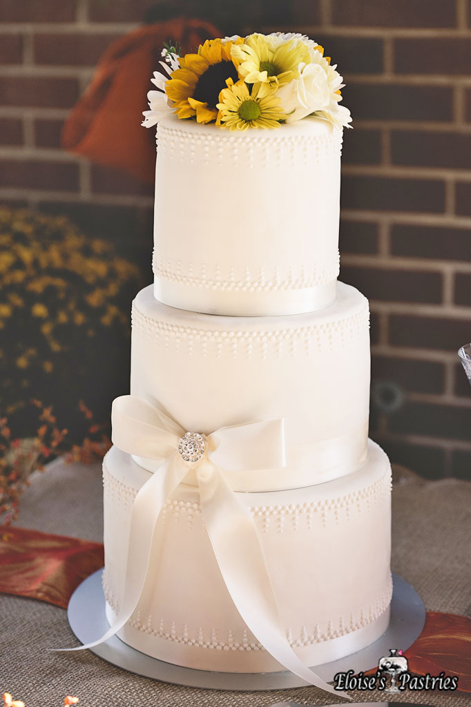Simply Elegant White Ribboned Cake