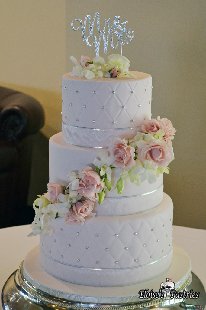 White Quilt Textured Cascading Floral Cake