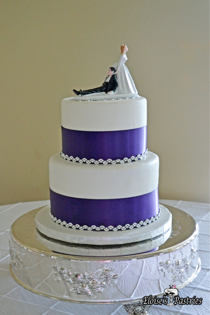 Blue Ribboned White Wedding Cake
