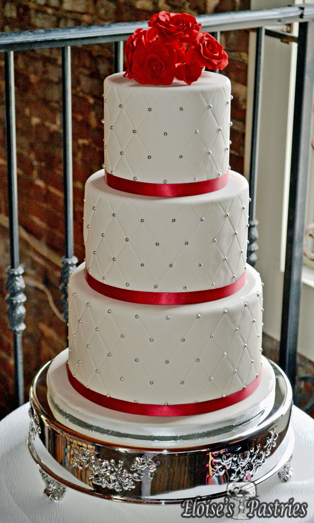 Red Ribboned Quilt Textured Wedding Cake