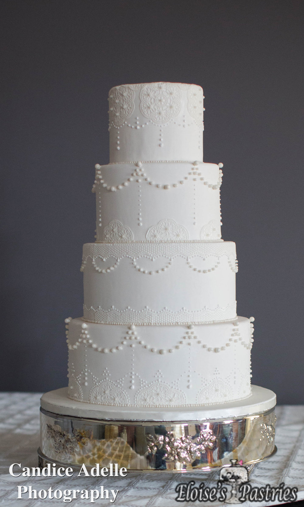 Fancy Intricate Detailed White Wedding Cake