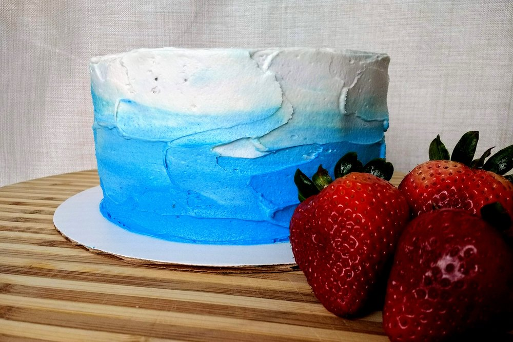 Beneath the Crust: strawberry-filled coconut cake with blue ombre frosting