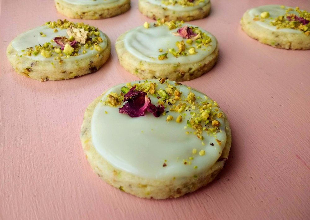 Beneath the Crust: Pistachio Rose Shortbread Cookies with White Chocolate Glaze