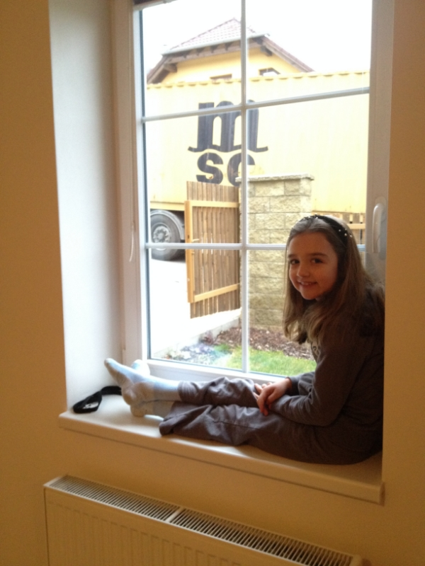 Hannah is watching them unload from inside--too cold out there!