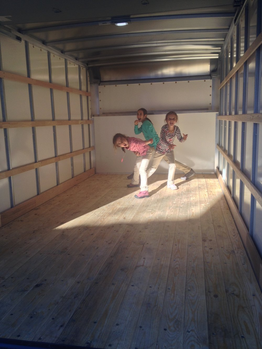 We rented a truck to get all our stuff from my in-laws' house to a warehouse.  The girls mistook it for a rock-star stage.