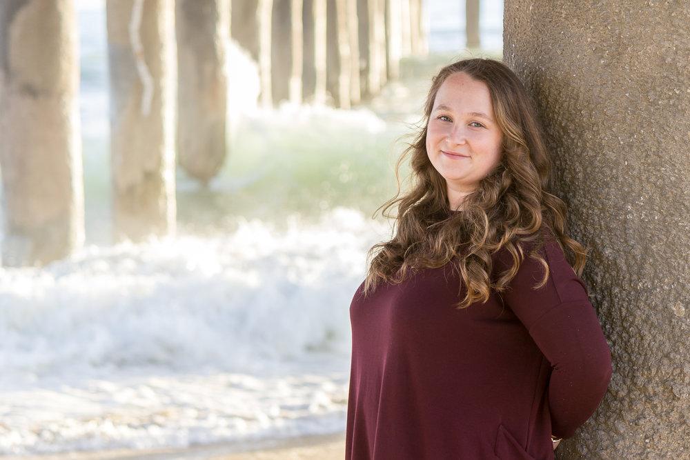 Senior Girl leaning on the Hermosa Beach Pier