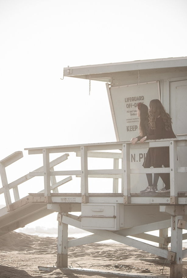 sisters looking at ocean from Hermosa Beach Lifeguard tower