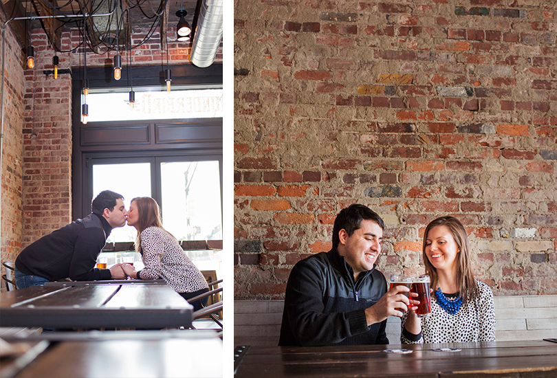 Fountain Square brewery Indiana engagement portrait photographer couple pose at table with draft beers toast brick wall Thunderbird bar.jpg
