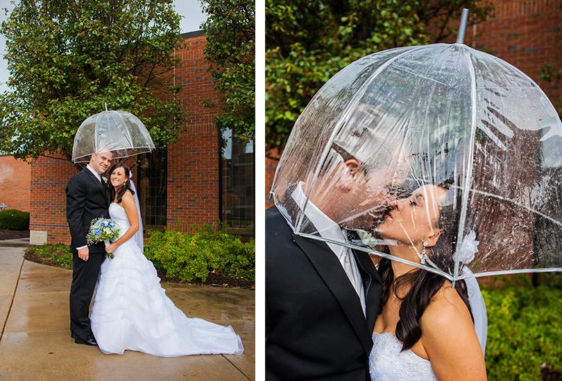 Speedway-Indiana-Saint-Christopher-catholic-church-wedding-photographer-bride-groom-kiss-under-umbrella-rainy-day-portrait.jpg