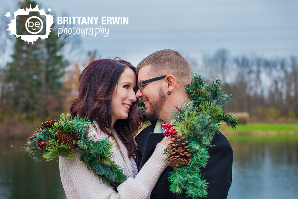 Christmas-elopement-wedding-photographer-couple-snuggle-outdoor-cold-garland.jpg