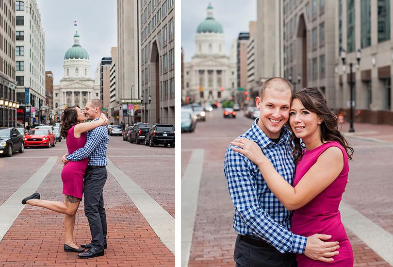 Downtown Indianapolis engagement portrait photographer couple on monument circle kiss