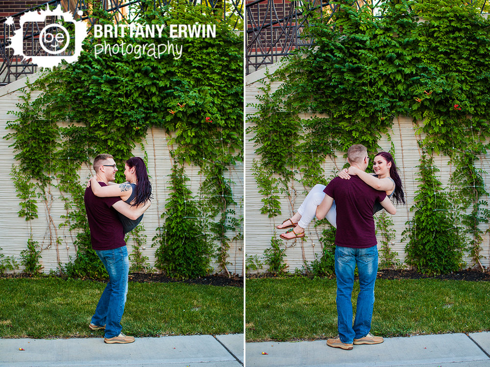 Downtown-Indianapolis-canal-engagement-portrait-photographer-couple-twirl-vine-wall.jpg
