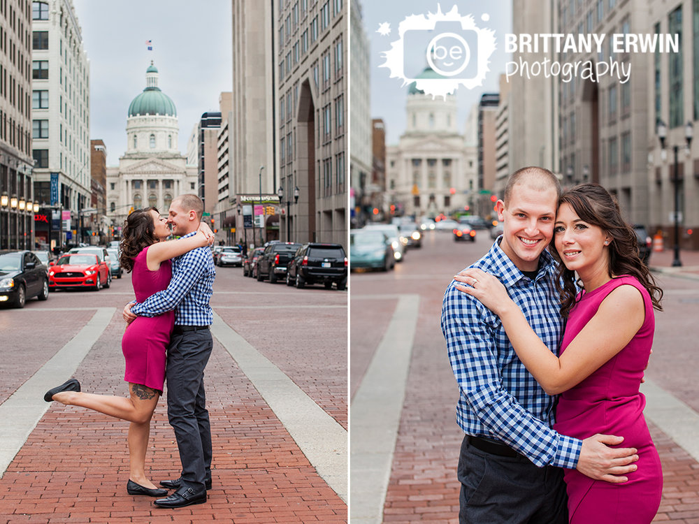 Downtown-Indianapolis-skyline-portrait-photographer-couple-on-monument-circle-in-street-engagment.jpg