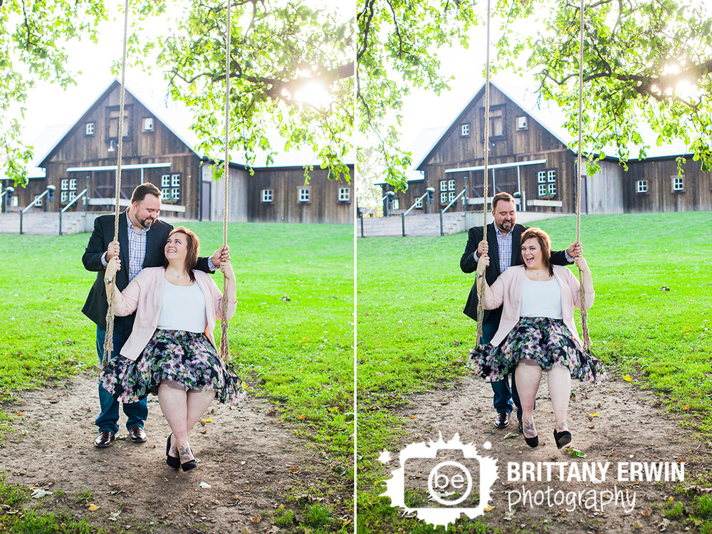 Engaged couple fun swing the barn