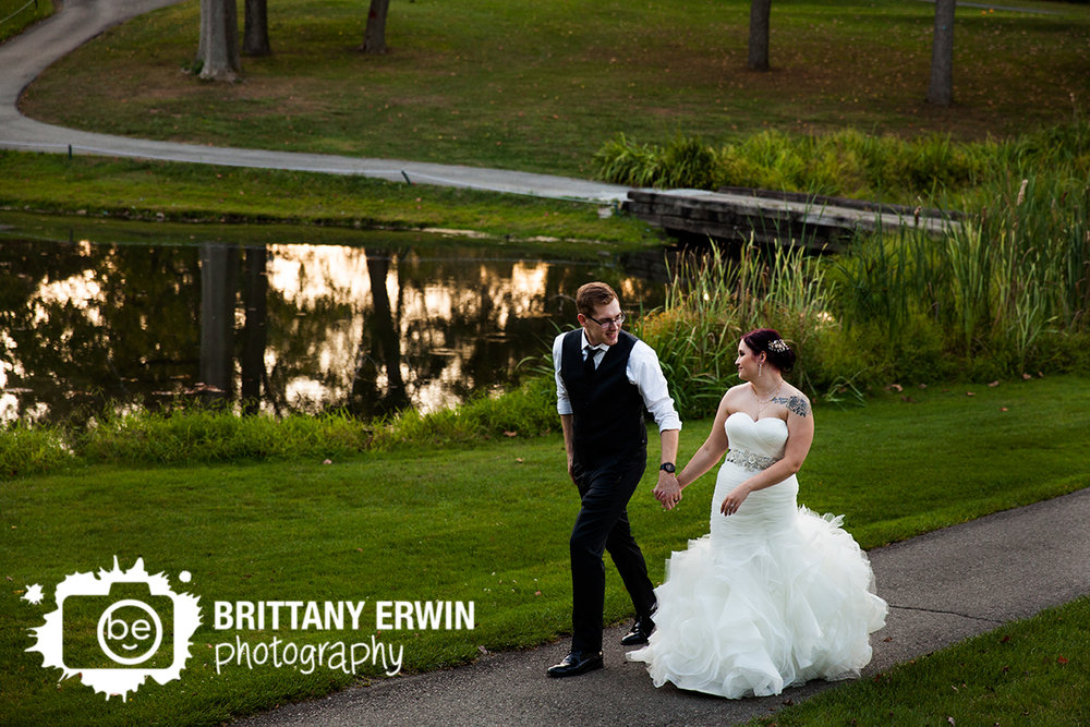 Indianapolis wedding photographer romatic walk by pond at Hillcrest Country Club