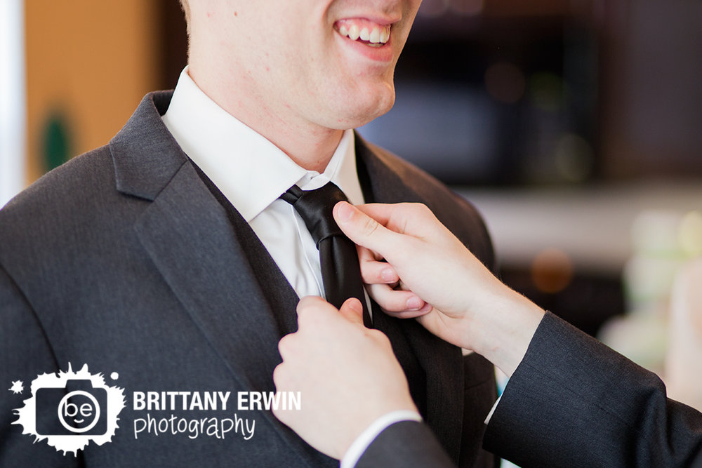 Indianapolis-wedding-photographer-groom-adjust-tie-getting-ready.jpg