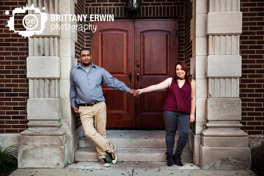 Indianapolis-fountain-square-engagement-portrait-photographer-couple-hold-hands-church-doorway.jpg