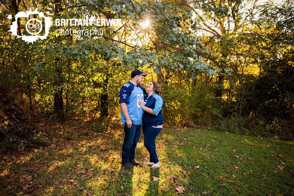 Camby Indiana engagement portraits in NFL Titans jersey