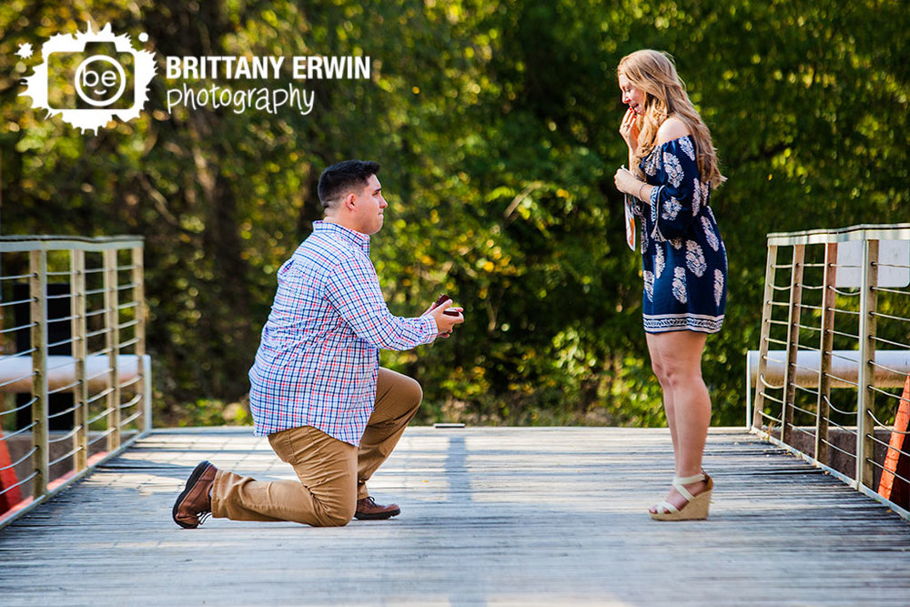 Indianapolis-museum-of-art-IMA-100-acres-park-surprise-proposal-photographer-couple-on-bridge-over-canal-she-said-yes-reaction.jpg