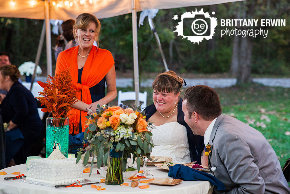 Story-Inn-tent-wedding-reception-photographer-couple-toasts-maid-of-honor.jpg
