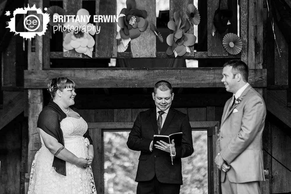Story-Inn-wedding-ceremony-photographer-couple-bride-groom-at-altar-paper-flower.jpg